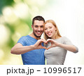 smiling couple showing heart with hands 10996517