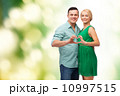 smiling couple showing heart with hands 10997515