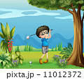 A boy playing golf near the tree 11012372