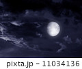 The moon in the night sky in clouds 11034136