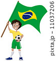 Happy soccer fan holds Brazilian flag 11037206