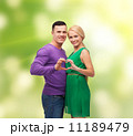 smiling couple showing heart with hands 11189479
