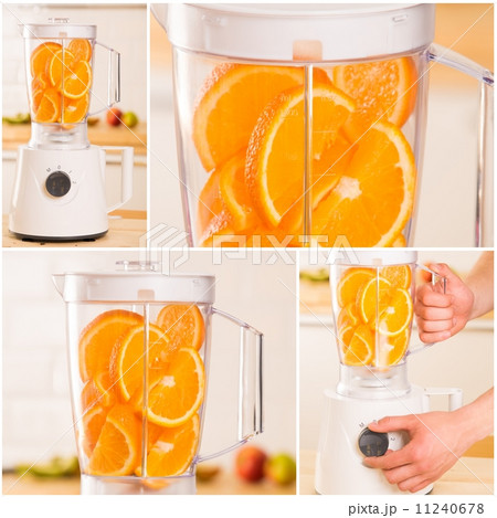 White blender with juicy oranges on a wooden tableの写真素材 [11240678] - PIXTA