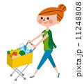 ショッピング カートを押す女性 11248808