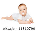 smiling baby lying on floor with dummy in mouth 11310790