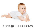 smiling baby lying on floor with dummy in mouth 11313429