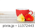 Cup of coffee and gerbera on wooden table 11372443