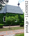 small chapel with green trees 11430652