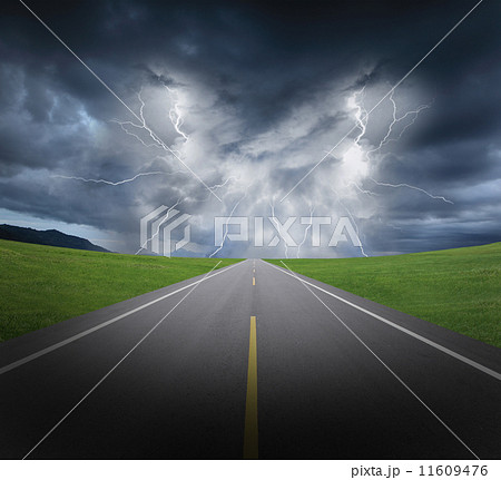 rainstorm clouds and lightning with asphalt road and grass 11609476