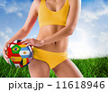 Composite image of fit girl in yellow bikini holding flag footba 11618946