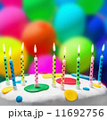 candles on a birthday cake on the background of balloons 11692756