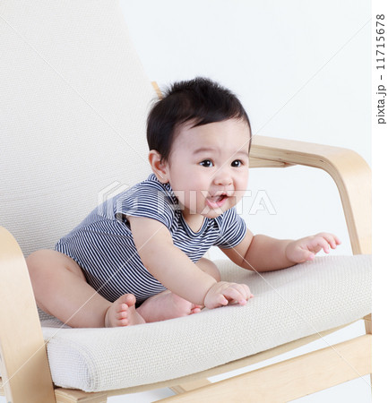 Thai baby sitting on the chair isolated 11715678