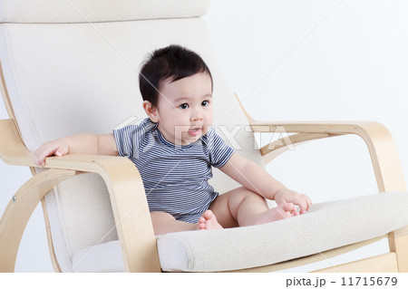 Thai baby sitting on the chair isolated 11715679