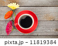 Cup of coffee and gerbera flowers 11819384