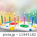 burning candles on a birthday cake 11945182