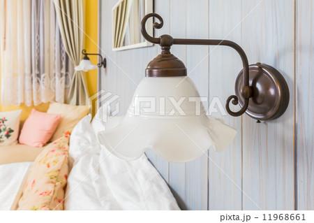 vintage wall lamp in the bed roomの写真素材 [11968661] - PIXTA