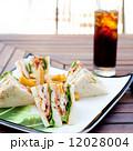 Club sandwich with iced soda drink 12028004