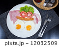 American breakfast with eggs ham bacon and sausage 12032509