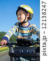 boy riding a bike 12138247