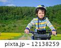 boy riding a bike 12138259