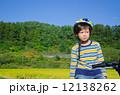 boy riding a bike 12138262