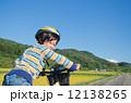 boy riding a bike 12138265