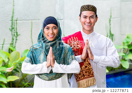 Asian Muslim couple wearing traditional dress 12277871