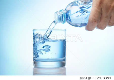 pure water is emptied into a glass of water from bottleの写真素材 [12413394] - PIXTA