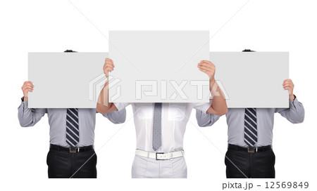 businesspeople holding posterの写真素材 [12569849] - PIXTA