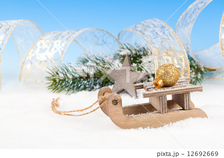 Christmas decoration over snow, blue backgroundの写真素材 [12692669] - PIXTA