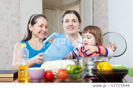 Happy family together cook in the kitchenの写真素材 [12715646] - PIXTA