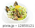 salad with vegetables and seafood on the table in a restaurant 12850121