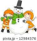 Kids Playing with a Snowman 12984376