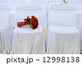 Wedding bouquet of red roses on white chair 12998138