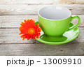 Coffee cup and gerbera flower 13009910