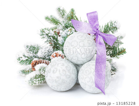 Christmas baubles and purple ribbon with snow fir treeの写真素材 [13185228] - PIXTA