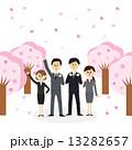スーツ姿の若い男女と桜並木 13282657