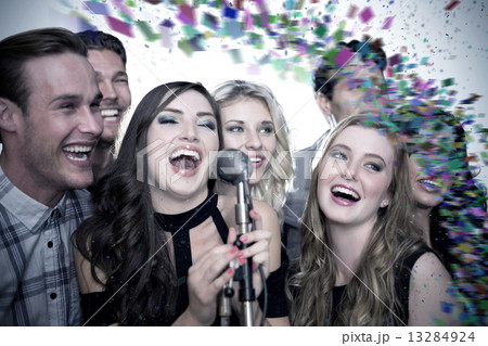 Composite image of friends singing karaoke 13284924