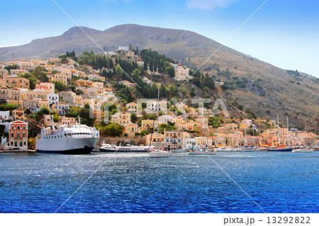 boats and houses on symi island, Greece.. 13292822