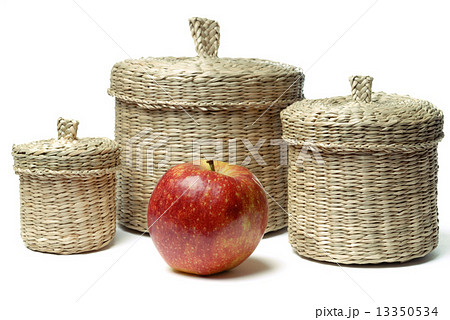 Three wattled baskets and apple isolatedの写真素材 [13350534] - PIXTA