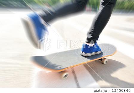 speeding skateboarding woman at city  13450346