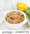 flakes in white bowl and yellow tulip 13463735