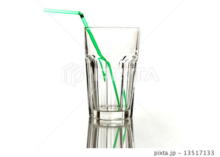 empty transparently glass with green straw isolated on whiteの写真素材 [13517133] - PIXTA