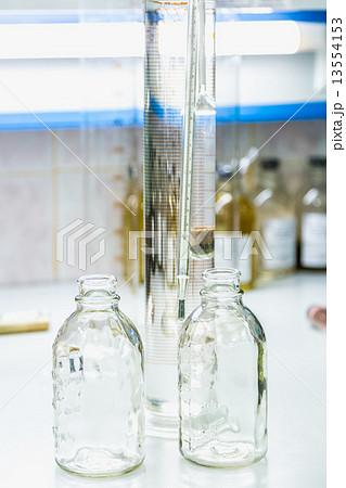 Empty glass bottles on table in laboratoryの写真素材 [13554153] - PIXTA