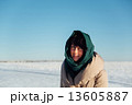 girl in a scarf on a sunny winter day 13605887