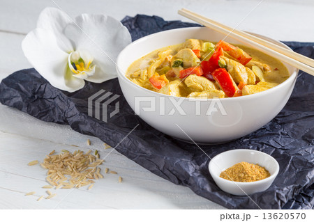 Thai Curry in a bowl on wood 13620570