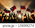 Group of People Waving Taiwanese Flags in Back Lit 13699274