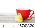 Cup of coffee and gerbera on wooden table 13763320