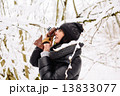 Girl photographs in winter forest  13833077