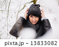 Portrait of a beautiful girl in winter forest 13833082